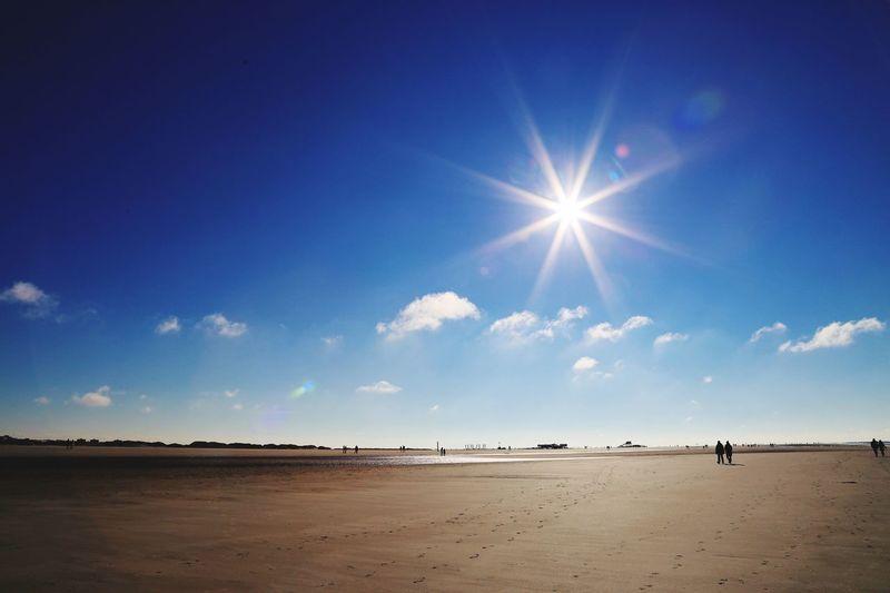 Sky Beach Scenics - Nature Water Sea Land Beauty In Nature Nature Sand Tranquility Tranquil Scene Horizon Over Water Non-urban Scene Outdoors Sunbeam Sunlight Incidental People Blue Sun Horizon