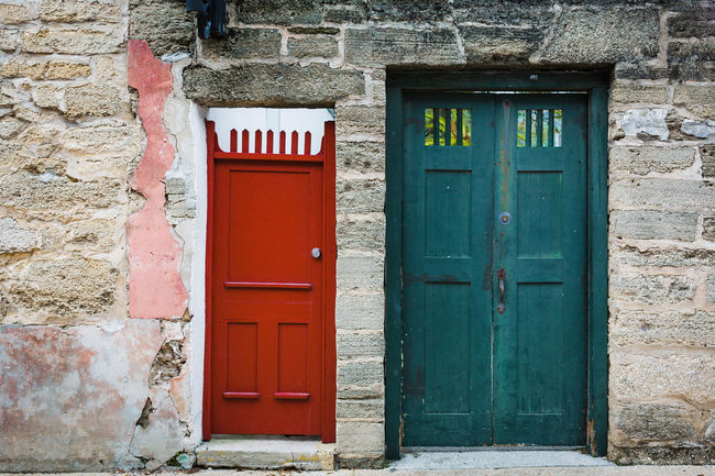 Antique Blocks Green Red Wall Architecture Building Exterior Built Structure Closed Door Cocquina Coquina Wall Day Door No People Old Architecture Old Buildings Open Door Outdoors Teal Color