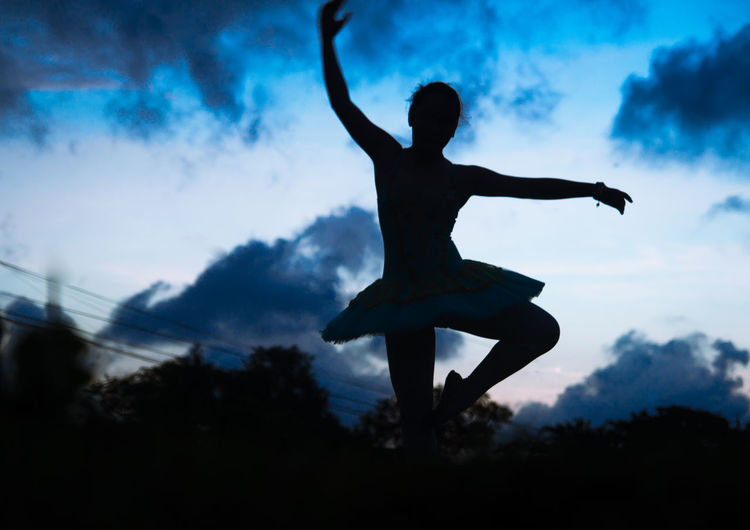 Ballerina Ballerina Ballet Dancer Ballet Pose Cloud - Sky Coordination Day Energetic Flexibility Full Length Jumping Men Mid-air One Person Outdoors People Real People Silhouette Sky