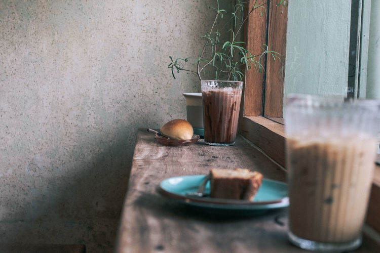 Iced coffee and chocolate in tall glass and fresh organic bread with spoon on rustic wooden table, selective focus Food And Drink Food Drink Table Refreshment Freshness Indoors  Glass Wood - Material Coffee Ice Ice Coffee Bread Cup Food And Drink Espresso Beverage Brown Cafe Delicious Breakfast Glass Sweet Cappuccino Backgrounds Restaurant Dessert White Bakery Bakery Cafe Snack Caffeine Addict Caffeine Morning Iced Baked Rustic Latte Chocolate Wood Fresh Vintage Wooden Bun Refreshing Homemade Japanese Food Cake Warm Coffee Break