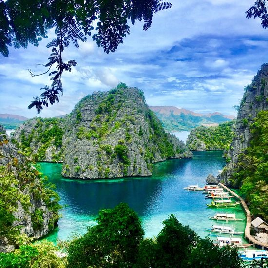 The most beautiful place i have ever visited Sea And Sky Sea Seascape Philippines Coron Tree Water Mountain Scenics Nature Beauty In Nature Nautical Vessel Tranquil Scene Tranquility Day Outdoors Sky No People