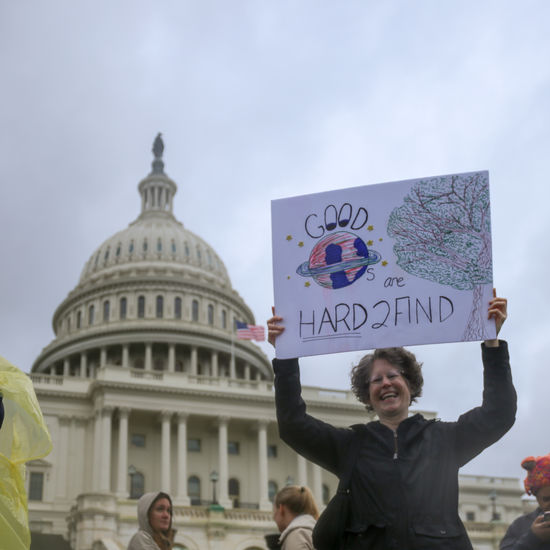 A protester at the March for Science in Washington, D.C. holds up a sign in front of the United States Capitol Building Activism Activist  Activists Capitol Day DC District Of Columbia March March For Science One Person Outdoors Politics Protest Protesters Rally Real People Science Signs United States Capitol Building