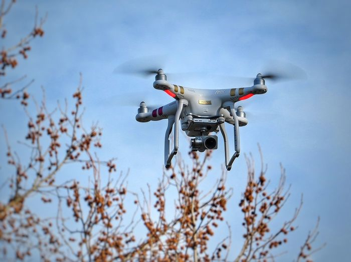 Low Angle View Of Drone Flying Against Sky