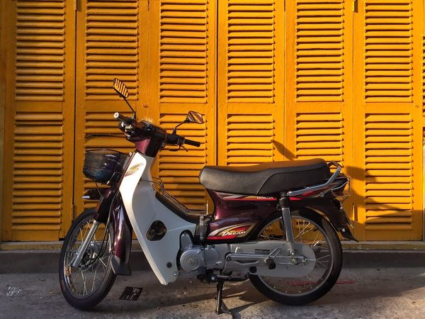 By the yellow door Transportation Stationary Mode Of Transport Building Exterior Motorcycle Built Structure Parking Outdoors Old-fashioned No People Architecture Day