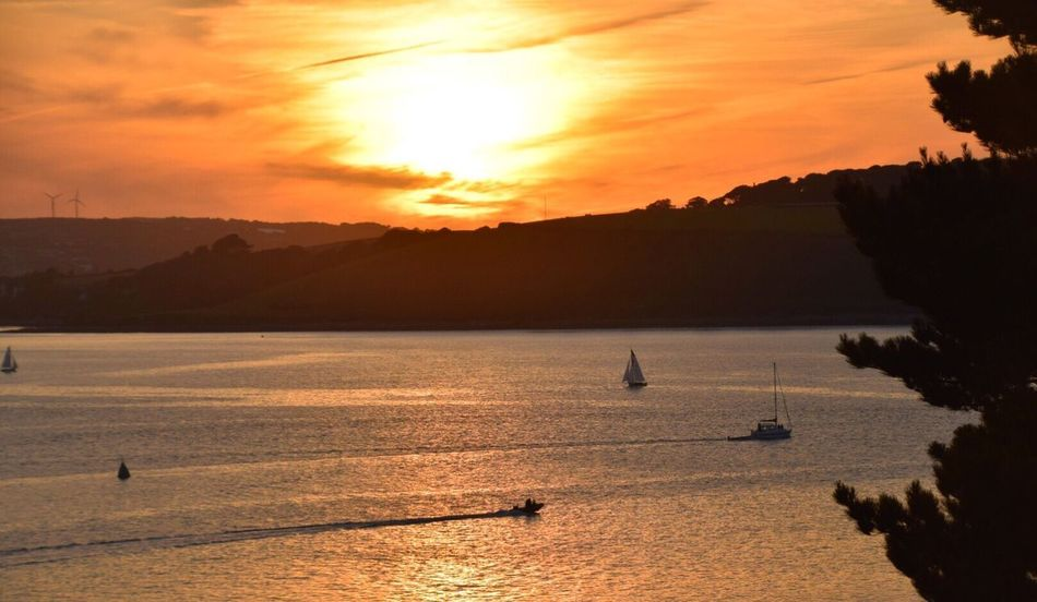 Sunset Water Scenics Beauty In Nature Silhouette Nature Sea Sky Mountain Nautical Vessel Transportation Tranquility Tranquil Scene Mode Of Transport Outdoors Cloud - Sky Sunlight No People Sailing Jet Boat Falmouth Bay Kernow Cornwall Uk