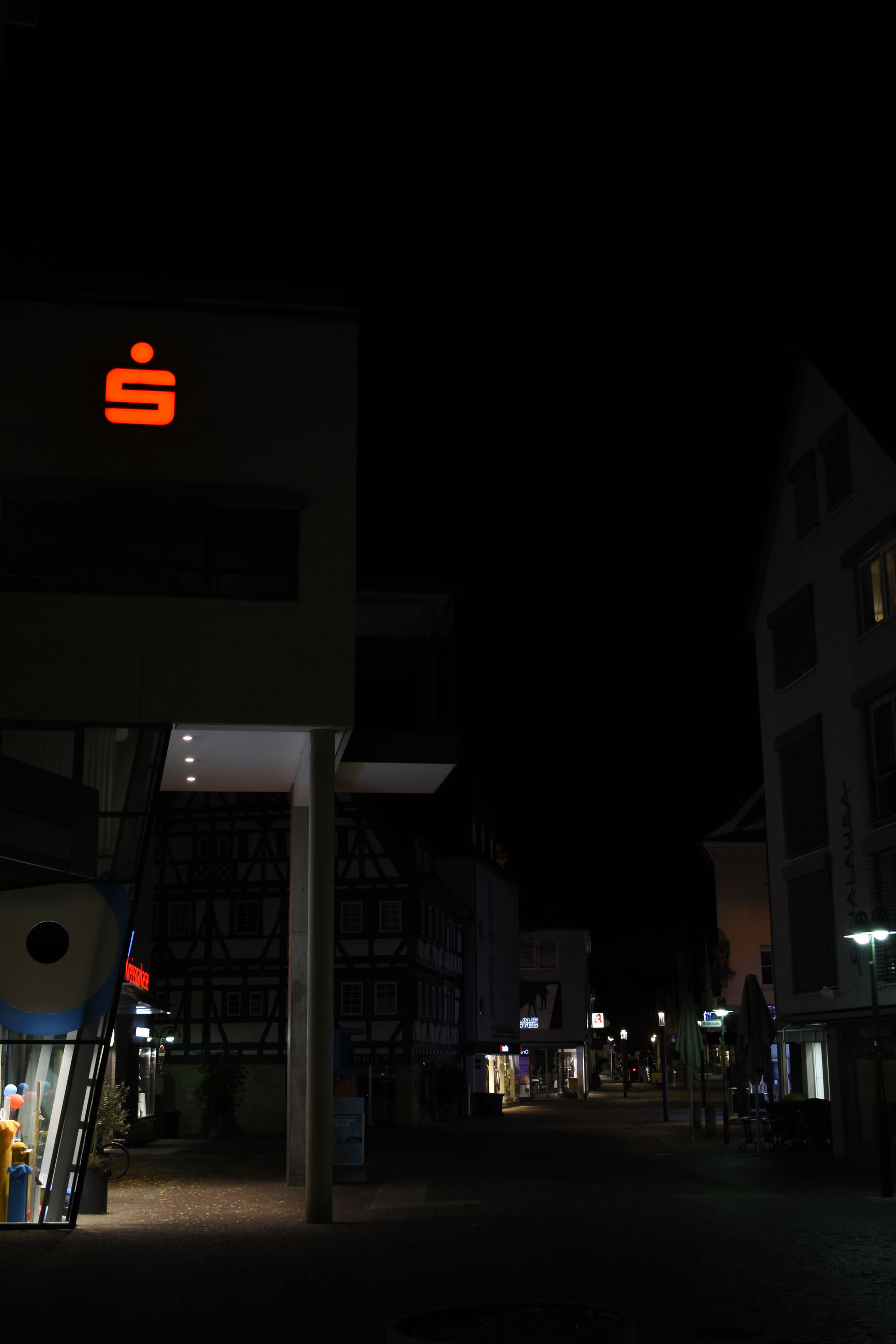 illuminated, sign, night, communication, architecture, built structure, city, building exterior, guidance, text, no people, western script, transportation, copy space, outdoors, street, information, lighting equipment, nature, information sign, light