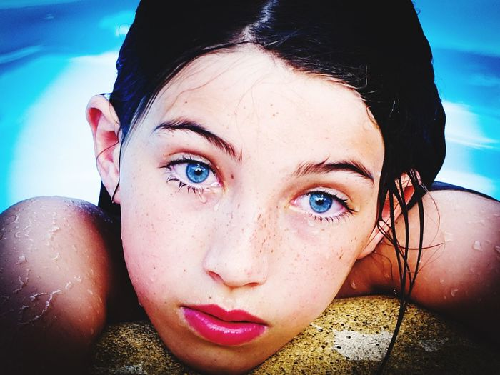 Close-Up Portrait Of Girl In Swimming Pool