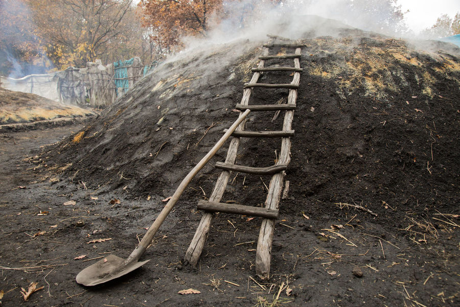 ladder on a charcoal mound Autumn Burning Charcoal Charcoal Mound Day Dirt Fall Istanbul Ladder Mound Outdoors Rungs Shovel Smoke Tools Turkey Wood