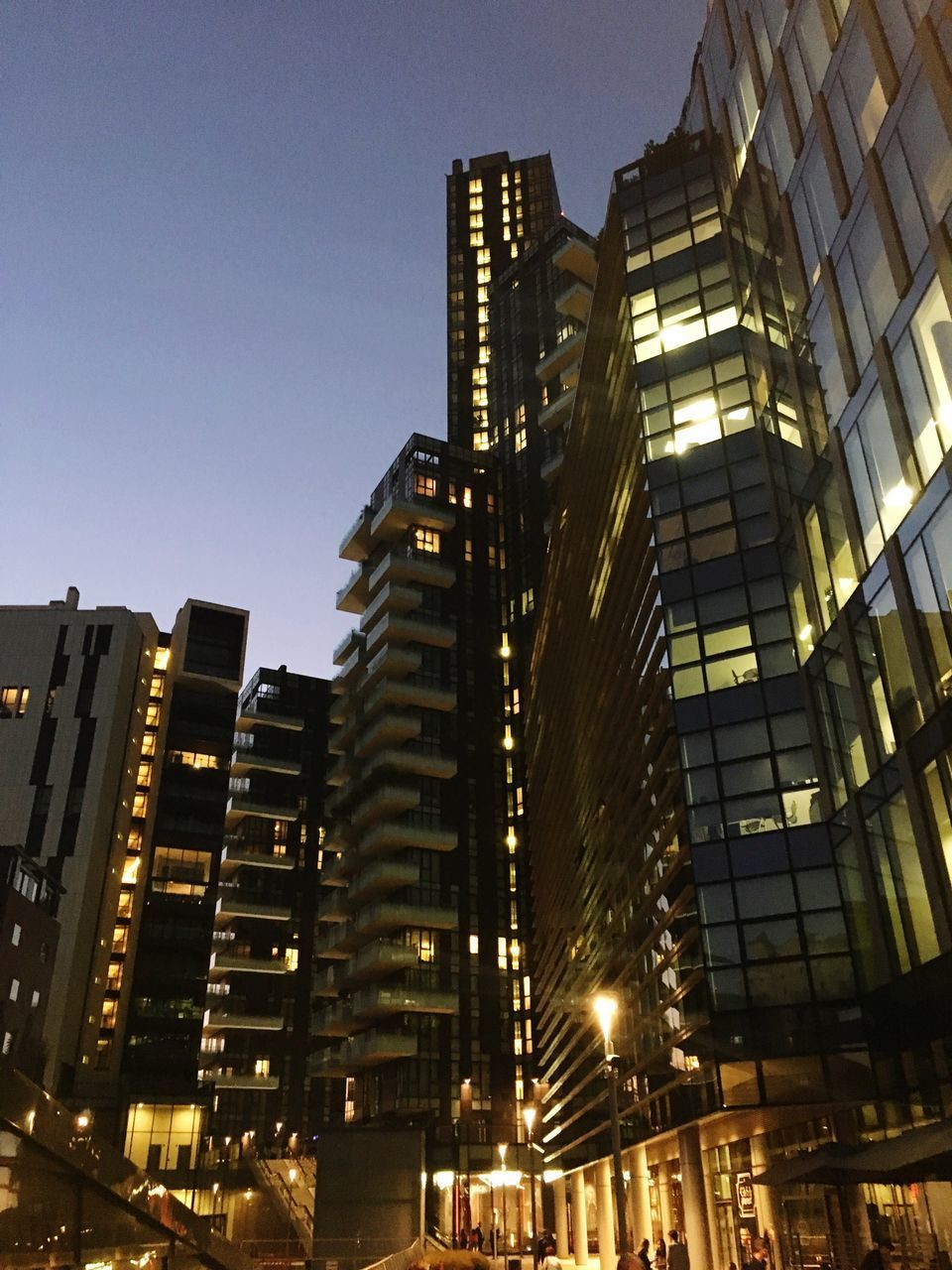 building exterior, architecture, built structure, illuminated, building, city, sky, low angle view, office building exterior, no people, tall - high, modern, skyscraper, dusk, clear sky, nature, office, night, outdoors, city life, financial district, apartment