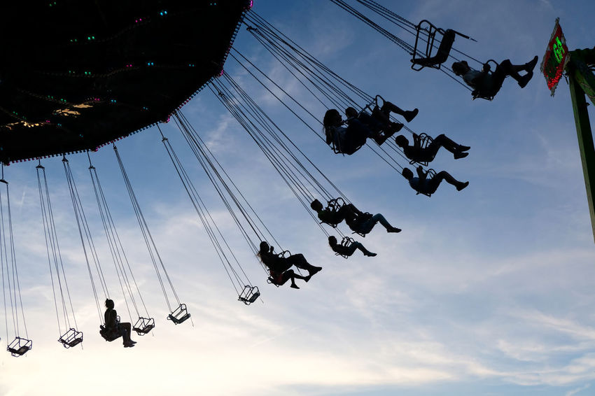 Amusement Park Amusement Park Ride Arts Culture And Entertainment Aschaffenburg Chairoplane Copy Space Day Enjoyment Excitement Fun Hanging Leisure Activity Lifestyles Low Angle View Motion Outdoors People Real People Silhouette Sky Togetherness Volksfest Volksfest Aschaffenburg