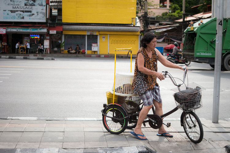 Side view of woman riding bicycle on road