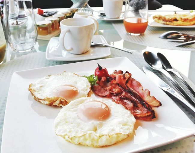 High angle view of fried eggs and ham in plate