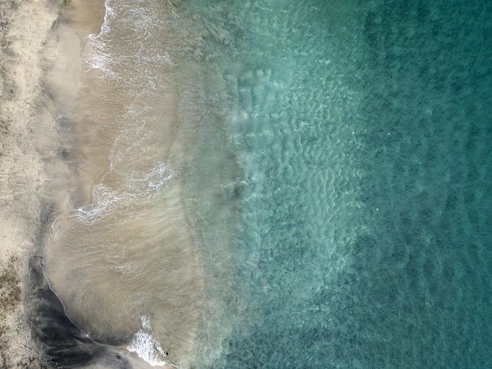 View of sea through rocks