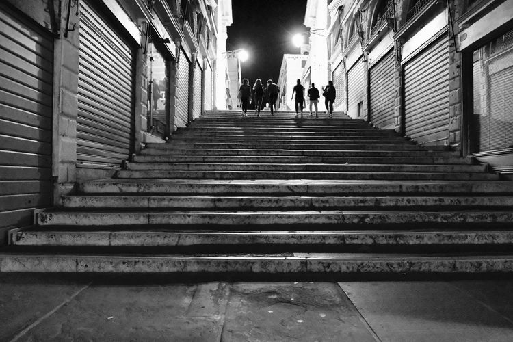 Black & White Adult Architecture Black And White Black And White Photography Built Structure Direction Group Of People Illuminated Incidental People Indoors  Lifestyles Low Angle View Men Moving Up People Railing Real People Staircase Steps And Staircases Street Street Photography The Way Forward Walking Women
