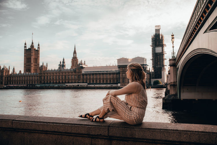 Big Ben Beuatiful Beautfildestinations Beautiful Woman London England Architecture Built Structure Building Exterior One Person Sitting Water City Sky River Travel Destinations Connection Lifestyles Adult Real People Nature Tourism Cloud - Sky Tower Hairstyle Bridge - Man Made Structure Hair Contemplation