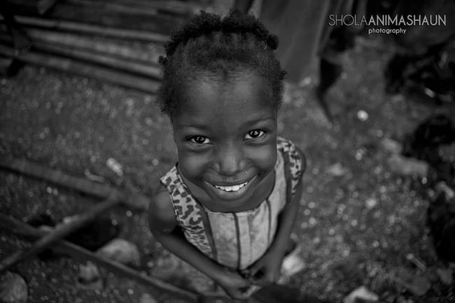 She lives in one of Africa's biggest slums and admist the chaos and poverty around her, when she smiled what I saw was hope. EyeEm Best Shots - Black + White EyeEm Africa Eyeem Nigeria Hope Diaries Of A Nigerian Photographer Shola Animashaun