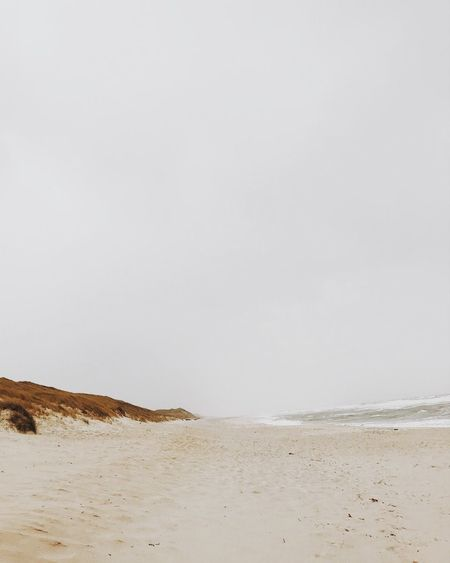 Beach Minimalistic Land Beach Sky Tranquility Beauty In Nature Copy Space Scenics - Nature Sand Sea Non-urban Scene Tranquil Scene No People Nature Water Day Clear Sky Outdoors Idyllic Landscape Arid Climate