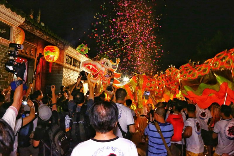 People On Street With Chinese Dragon In City At Night During Traditional Festival