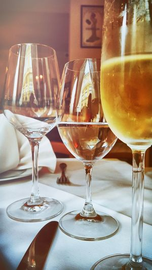 Close-Up Of Wineglasses Served On Dining Table In Restaurant