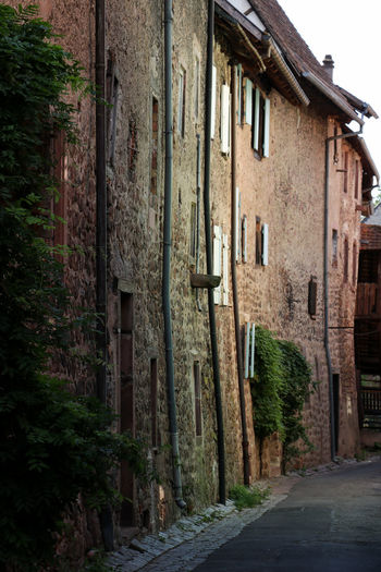 Old buildings Alsace Alley Architecture Building Building Exterior Built Structure City Direction Footpath House Narrow Nature No People Old Old Buildings Outdoors Plant Residential District Road Street The Way Forward Town Wall My Best Photo The Architect - 2019 EyeEm Awards