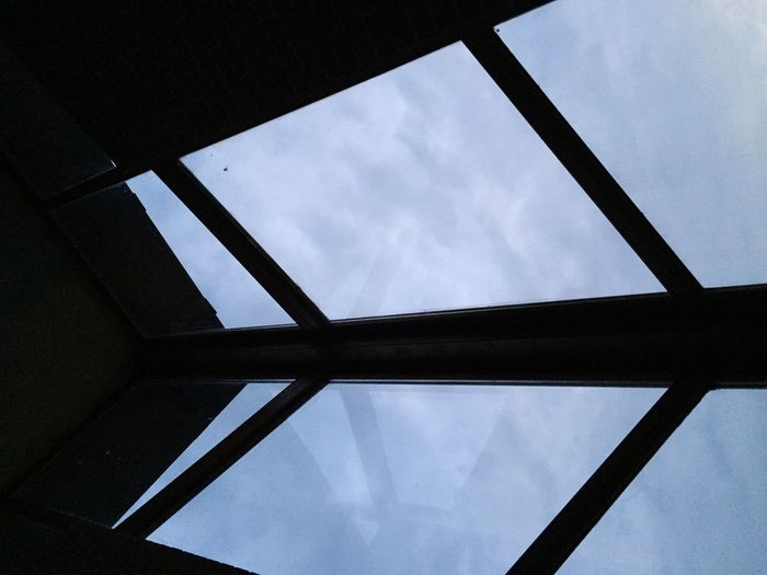 Indoors  Window Architecture Geometric Shape Skylight Built Structure Sky Cloud - Sky Architectural Feature Window Frame Spider Lines And Shapes Perspective Personal Perspective Abstract Light Up Your Life Sunlight Blue Blue Sky Color Palette A Bird's Eye View