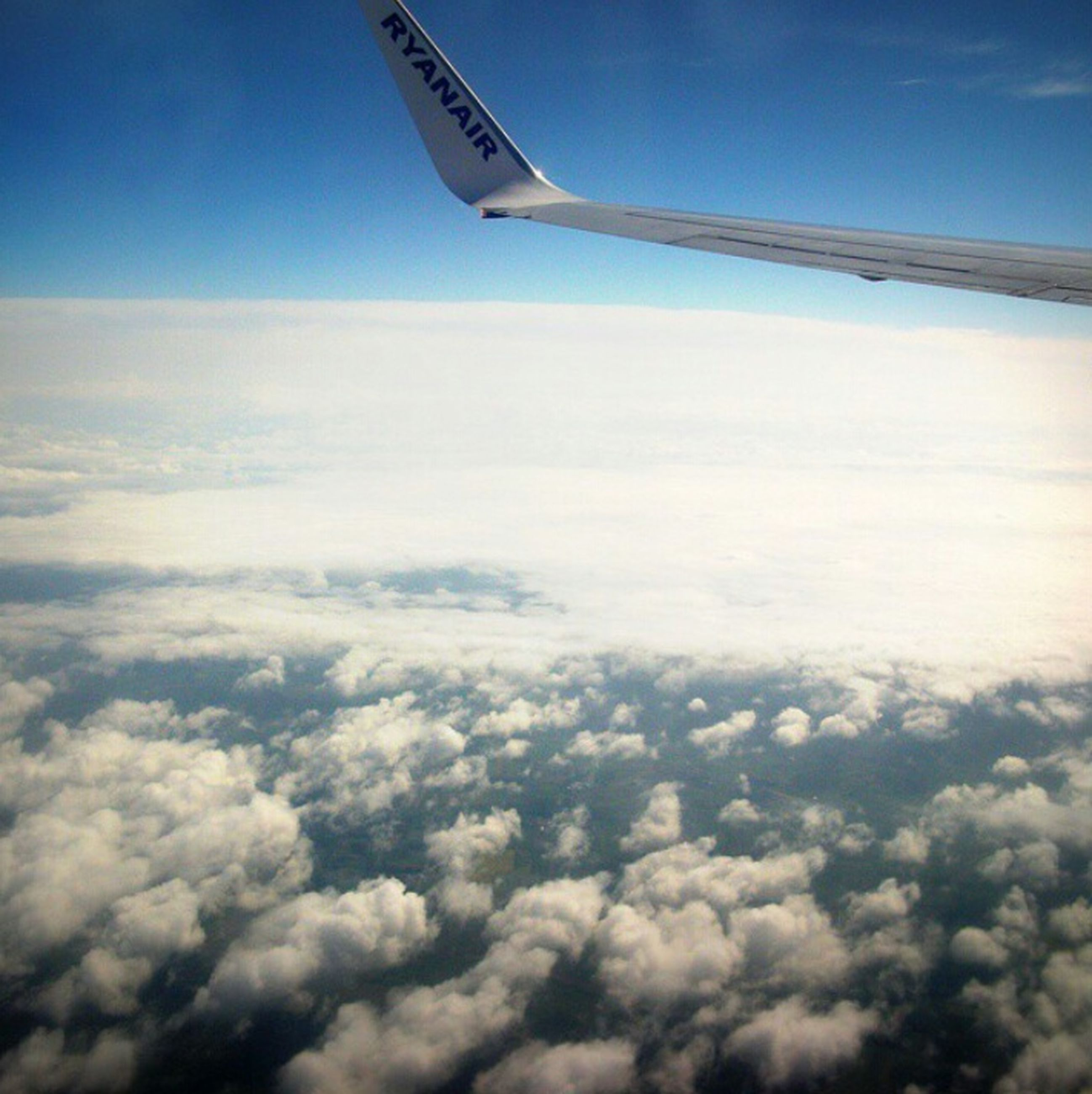 airplane, cloud - sky, aerial view, sky, flying, transportation, scenics, nature, air vehicle, travel, outdoors, no people, day, beauty in nature, aircraft wing, landscape, plane, airplane wing