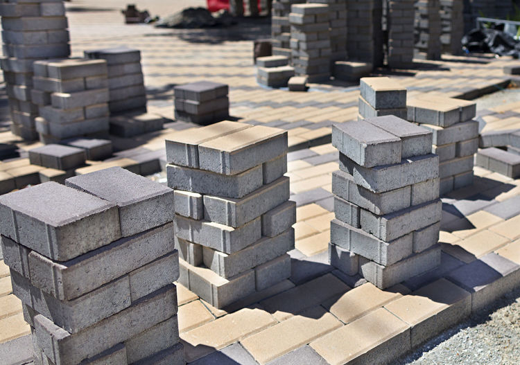 Stack of paving stone at footpath