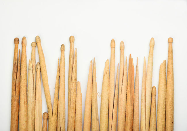 Range of old broken wooden drumsticks Broken Brown Chart Collection Drumsticks Evolution  Fence Grunge Instruments Learning Music Musical Musical Instrument Pivotal Ideas Old Practicing Range Rock Row Telling Stories Differently Used White Background Wood Wooden Your Design Story