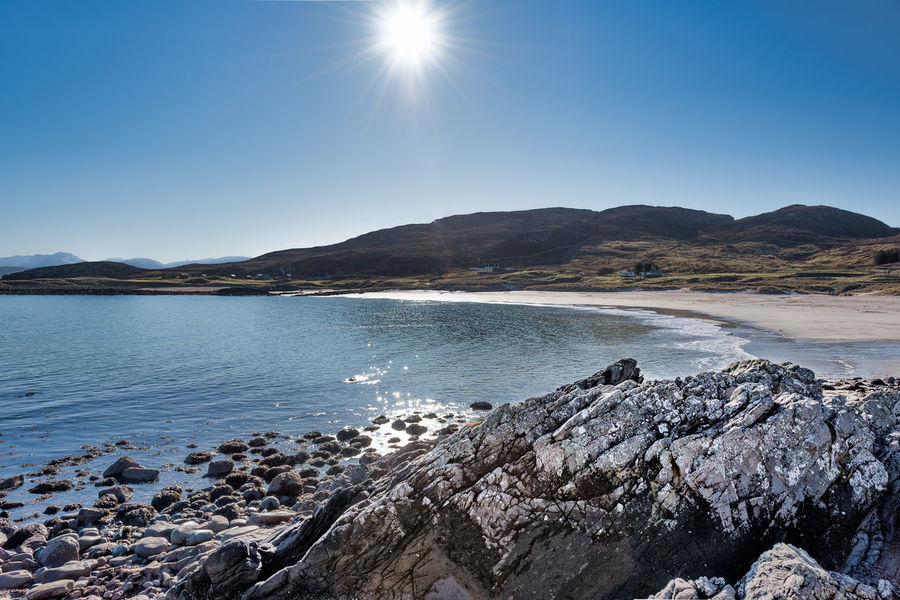 Hills Mellon Udrigle Beach Scotland 💕 Clear Blue Sky And Sea Holiday Destination Rocky Foreshore Sandy Beach Sea Sun In Sky Mountain Nature Rock - Object Beauty In Nature Tranquility Tranquil Scene Sunlight No People Clear Sky Outdoors Scenics Water Sky Sun Day Blue