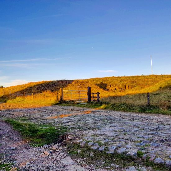 Overview of rivington pike Landscape Tranquil Scene Tranquility Scenics Clear Sky Field Blue Copy Space Fence Protection Beauty In Nature Sky Nature Remote Wooden Post Growth Non-urban Scene Solitude Outdoors Rural Scene