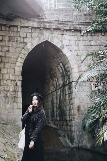 Miles Away One Person Real People Built Structure Architecture Standing Lifestyles Brick Wall Building Exterior Leisure Activity Arch Portrait Day Indoors  Young Adult Adults Only Adult People Portrait Of A Woman The Secret Spaces