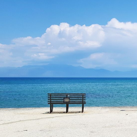 Let's sit down! Beauty In Nature Bench Blue Calm Cloud Cloud - Sky Cumulus Cloud Day Dramatic Sky Empty In Front Of Nature Ocean Outdoors Park Bench Remote Scenics Sea Sky Solitude Tourism Tranquil Scene Tranquility Water My Year My View Sommergefühle Lost In The Landscape