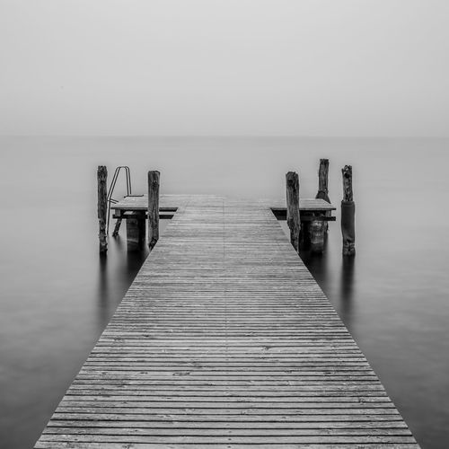 B&W jetty on a lake Beauty In Nature Blackandwhite Horizon Over Water Italia Italy Jetty Jetty Area Jetty View Lake Lake View Lakescape Lakeside Landscape Longexposure Nature No People Pier Silence Tranquil Scene Tranquility Water Wood - Material