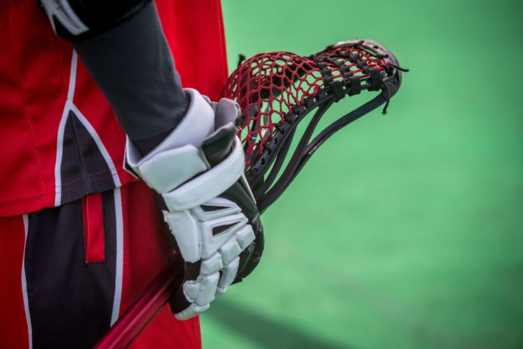 Close-up of sportsperson holding racket