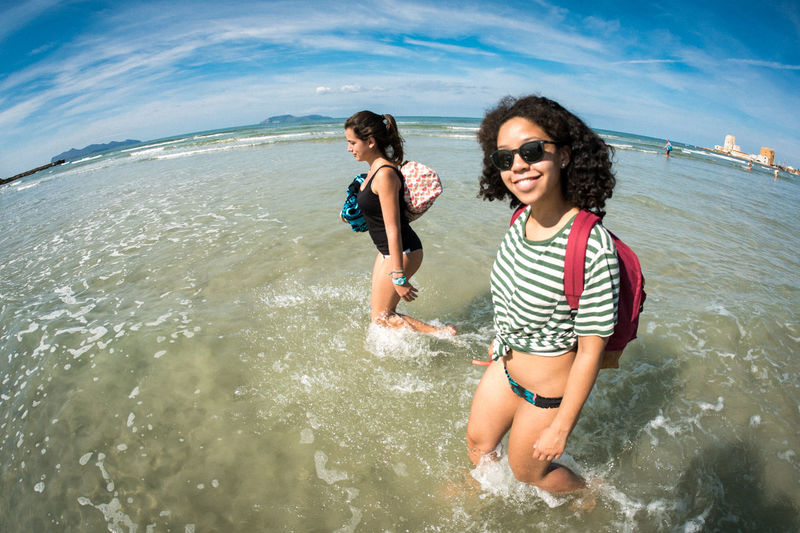 Beach Beach Holiday Beauty Bonding Carefree Enjoyment Friendship Fun Happiness Leisure Activity Mid Adult People Sand Sea Smiling Summer Sunglasses Togetherness Travel Two People Vacations Vitality Water Wave Young Women