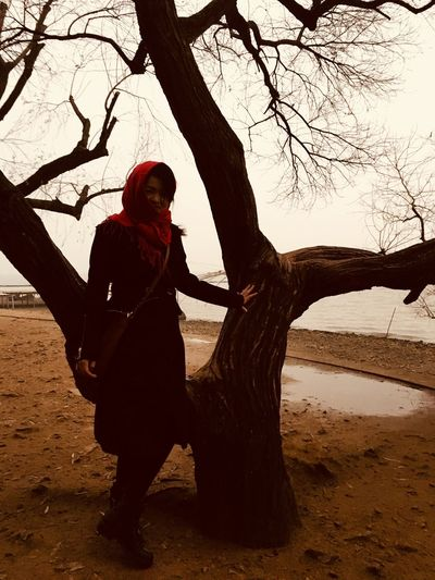 Tree Tree Trunk Bare Tree Branch Real People Full Length Outdoors Nature One Person Beauty In Nature Young Adult People