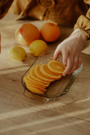 Close-up of person preparing fruits on cutting board