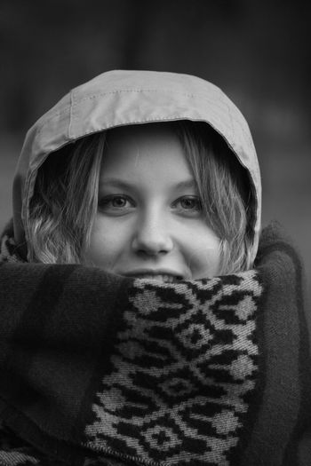 Close-up portrait of teenage girl covered with shawl