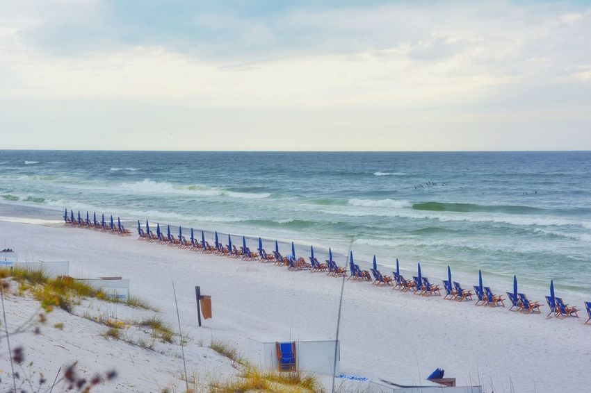 Off season Beach Chairs Coastline Horizon Over Water Leisure Activity Lifestyles Ocean Off Season Outdoors Peace And Quiet Sand Sea Shore Sky Vacation Vacations View From Above Water Wave