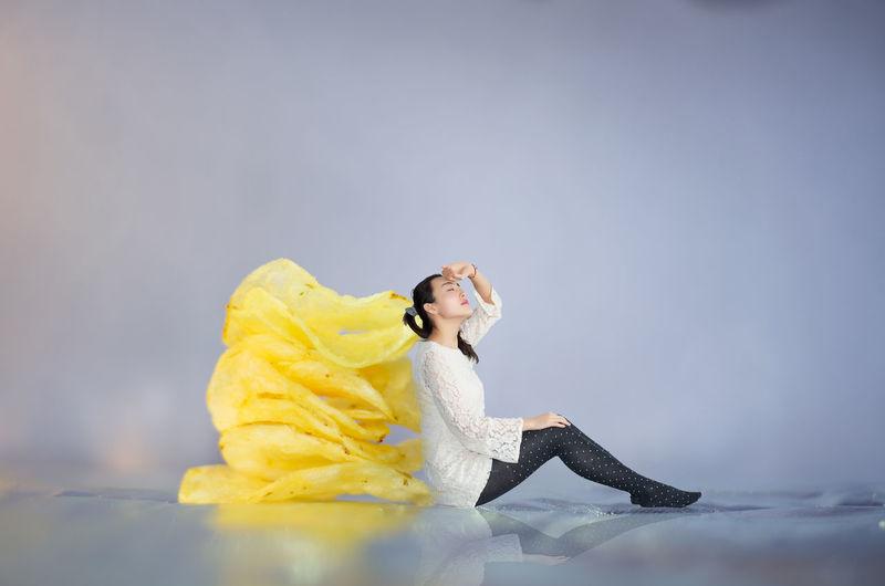 Woman with yellow umbrella