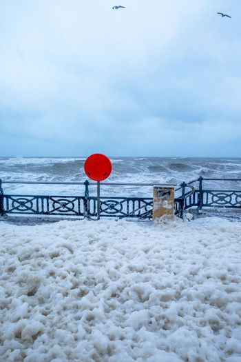 Brighton Sea Foam On The Beach Storm Stormyseas Beach Beauty In Nature Brighton Uk Brightonbeach Cloud - Sky Cold Temperature Day Flying Horizon Over Water Nature No People Outdoors Railing Red Scenics Sea Sea Foam Sky Snow Water Winter