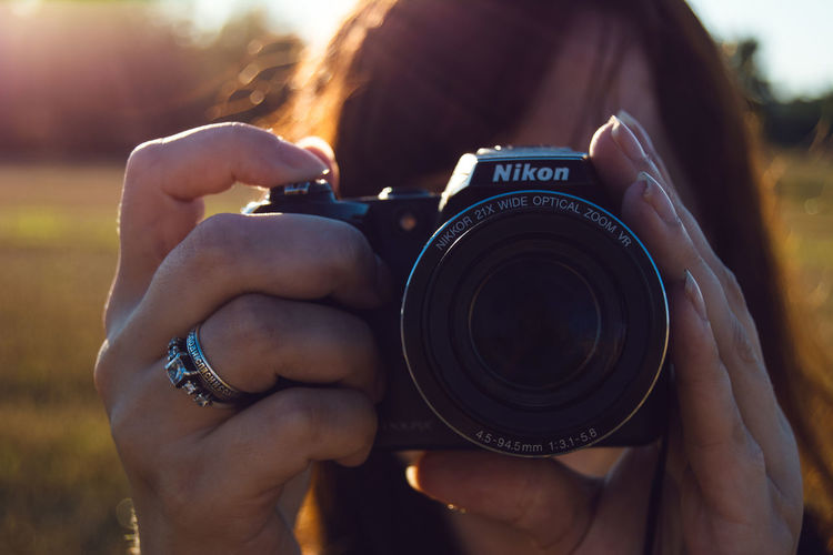 By Ivan Maximov Camera Camera - Photographic Equipment Close-up Cropped Digital Camera Focus On Foreground Holding Leisure Activity Lens - Optical Instrument Lifestyles Nikon Lover Nikonphotography Not For Sale Outdoors Part Of Person Personal Perspective Photographer Photographing Photography Themes Technology Unrecognizable Person Wireless Technology Showcase July Lieblingsteil
