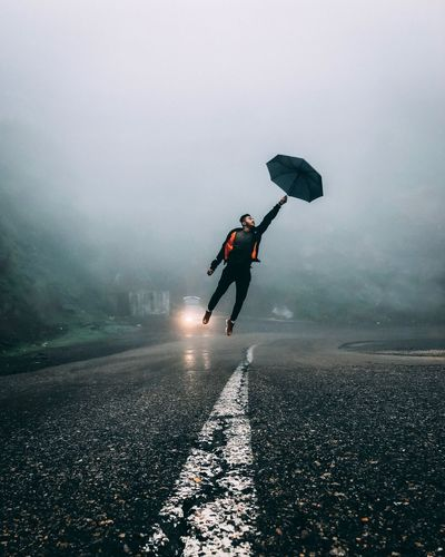 Your dreams are what define your individuality. They have the power to give you wings and make you fly high . Tourism Landscape Photography Water Nature Sky Sport People Sea Fog Adventure