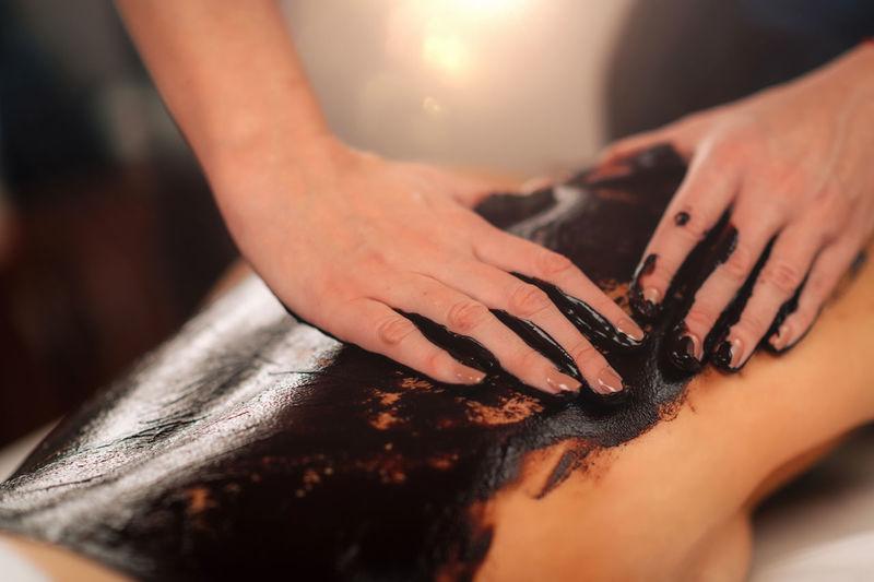 Relaxing chocolate back massage at wellness center.