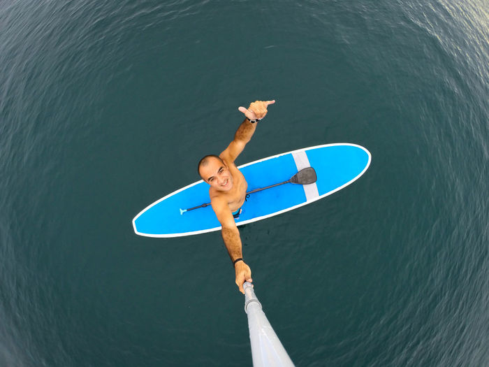 High angle view of man with boat in sea