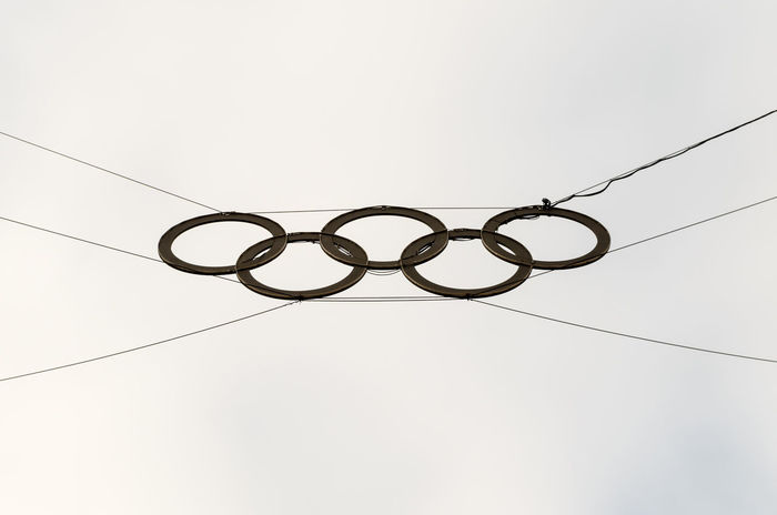 Olympic rings in Berlin, Germany. Olympic Rings Abstract Power Line  Chain Steel Symbol Shape Wire Rope No People Sky Backgrounds Day Outdoors Defocused Nature Close-up Low Angle View White Background Cable Colour Your Horizn Inner Power