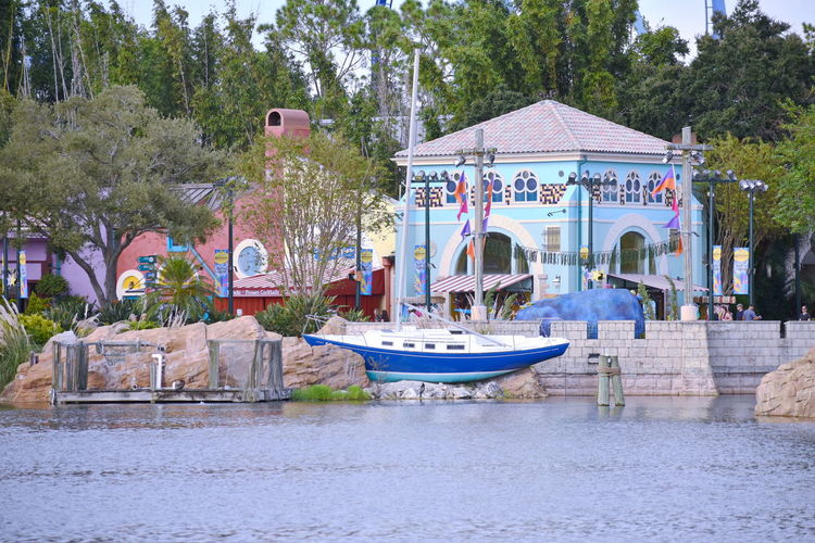 Orlando, Florida. October 19, 2018 Colorful african style architecture and sailing boat on forest background at Seaworld MarineTheme Park. Adventure Amusement Park Attraction Blue Theme Park Funny People Leisure Outdoors Park Ride Show Us Your Thirty Show Shopping Vacations Seaworld Universal Studios  DisneyWorld Walt Disney World Orlando Florida Rollercoaster Action Fall Roads Animal Sealion  Water Park