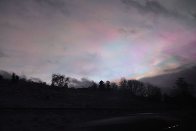 Scenic view of rainbow against sky at sunset