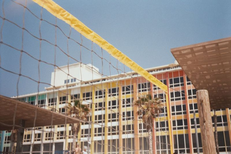 Low angle view of net against building