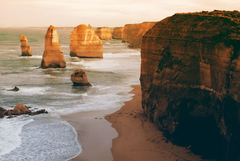 The Twelve Apostles in morning 1. Cliffs Beach Beauty In Nature Cliff Day Horizon Over Water Landmark Landscape Nature No People Outdoors Physical Geography Rock - Object Rock Formation Sand Scenics Sea Shore Tourism Tranquil Scene Tranquility Travel Destinations Water Wave